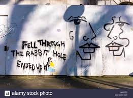graffiti rabbit stock photos graffiti rabbit stock images alamy alice in wonderland and faces graffiti fitzroy square fitzrovia london uk