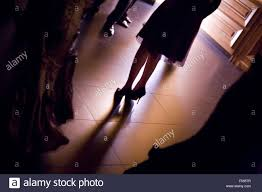 feet of young woman wedding guest in high heel shoes and cocktail