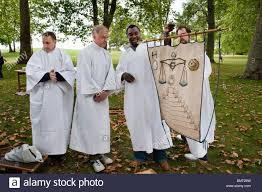 druidic robes four druids in white robes with traditional banner with druidic