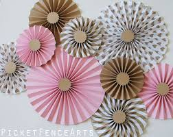 pink and brown paper rosettes paper fans backdrop pink and