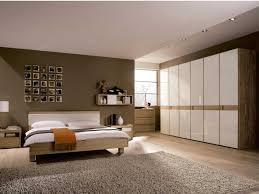 Bedroom Design Hardwood Floor Bedroom Black Beds Pendant Lights White Rug Brown Hardwood