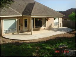 backyards bright stamped concrete patio with seating walls