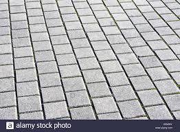 background with floor tiles of granite paving stones stock photo