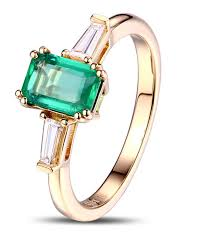 gold emerald engagement rings 1 carat emerald and trilogy engagement ring in yellow gold