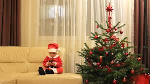 amusing santa claus play with ornaments hear shape gift