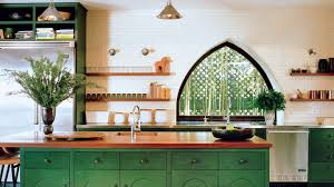 green kitchen walls exposed brick tile backsplash stainless