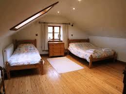 attic closet doors plain white wall paint light black padded bed
