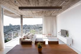 concrete ceiling a white house with a void ground floor for entertaining guests