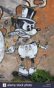 mickey mouse graffiti street art on old quay wall in almada stock mickey mouse graffiti street art on old quay wall in almada portugal