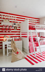 striped red and white wallpaper in children u0027s room with patchwork