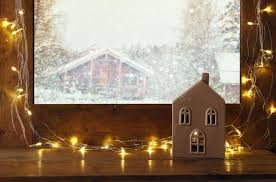 window sill with lights in front of winter background