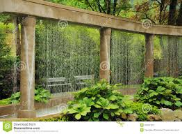 decorative water wall in the garden royalty free stock image