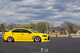 mitsubishi lancer wallpaper iphone mitsubishi lancer evo x yellow cars walldevil