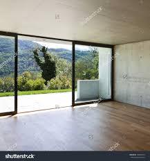 modern concrete house with hardwood floor large window stock save