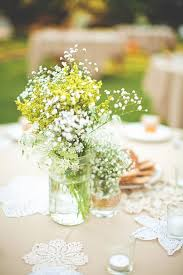 baby breath centerpieces wildflowers and even weeds in the jar simply beautiful and