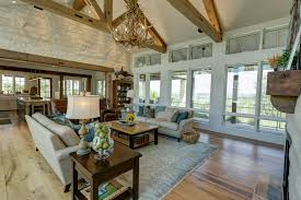 family room with wall of windows timber roof trusses interior