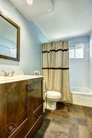 bathroom design bathroom brown tile floor blue decor curtain