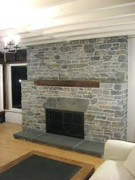 stone fireplace surrounds covering brick veneer 70s makeover diy