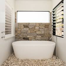 30 exquisite inspired bathrooms with stone walls half wall in natural stone and pebbles on the floor turn the the small bathroom into a relaxing hub