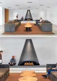 this cone shaped black steel fireplace design sets a contemporary