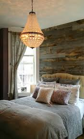 pottery barn mia chandelier over the bed one of my favorites pottery barn mia chandelier over the bed rustic industrial stikwood wall keeps the whole look from feeling too prissy farrow and ball brassica on the