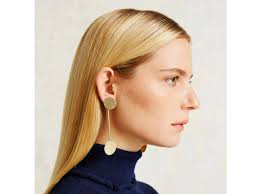 how statement earrings can help big ears look smaller huffpost