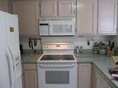 kitchen cabinets before i painted them pickled oak a trend that