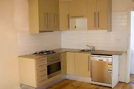 kitchens with white cabinets and yellow walls preferred home