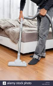 Vacuum Cleaners For Laminate Floors The Man Cleaning His Room With Vacuum Cleaner Stock Photo Royalty