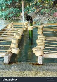 japanese purification fountain shinto temple bamboo stock photo