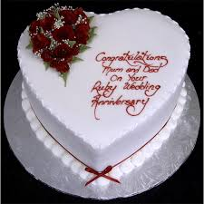 heart shaped ruby wedding anniversary cake with red roses and