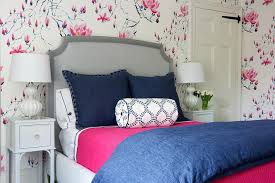 design guild pink and blue bedroom with gray bed and nightstands transitional