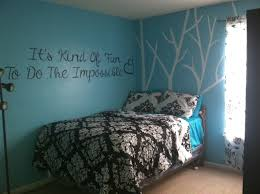 white branch and quotes sticker wall decal on teal bedroom wall