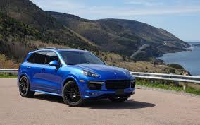 porsche suv blacked out porsche cayenne gts and macan turbo on the cabot trail the car guide