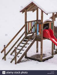 wooden playing house for kids with slide stock photo royalty free