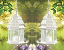 set of 15 large white metal moroccan candle lanterns vine pattern