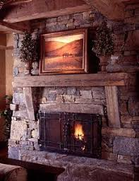 Fireplace Mantel Shelf Plans by Fireplace With Built In Wood Storage Niches And Rough Hewn Mantle