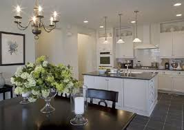 white kitchen cabinets black tile floor white shaker cabinets traditional kitchen kb home