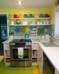 blue kitchen cabinets and yellow walls small kitchen designs in yellow and green colors accentuated