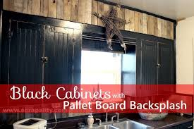 black backsplash in kitchen black chalkboard cabinets with pallet backsplash hometalk