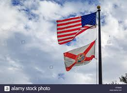 Florida Flag Facts Florida State Flag With American Flag With Cloudy Sky Background