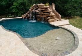 fantastic swimming pool with unique shape and water fountain idea