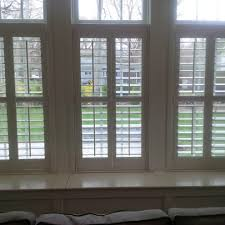 new york hunter douglas shutters living room transitional with bay