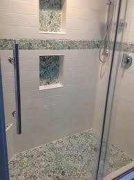 bathroom tile green glass subway tile herringbone backsplash
