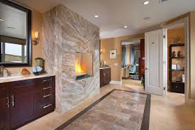 Contemporary Master Bathrooms - bathroom middle wall fireplace plus dark wooden vanity cabinets