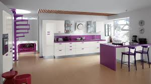 small apartment kitchen with purple back splash and stools