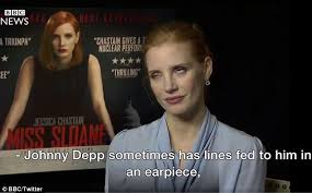 jessica chastain rolls eyes at johnny depp u0027s earpiece daily mail