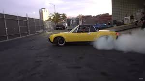 classic porsche 914 jeff zwart rips donuts in his porsche 914 6 at the hoonigan garage