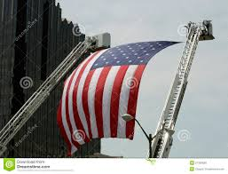 Indiana Flag Images An Large American Flag Hanging Between Firetruck Ladders Stock