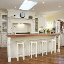 white wooden kitchen cabinet and island with gray counter top